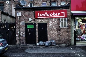 1/5 Immigrant Landscapes: a photo series in Southall I remember speaking to a Canadian who found the name of this gambling spot hilarious. I find it captures the area's juxtaposition well, especially next to a suit.